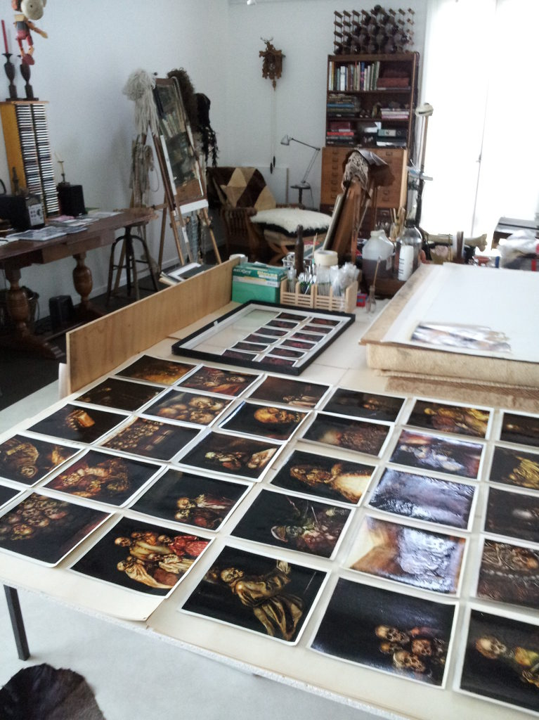 Photographs of Terry Taylor's artwork on table in her studio